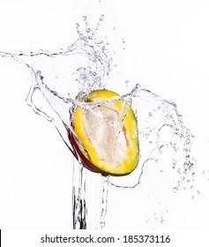 Mango with water splash isolated on white