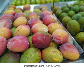 mangoes for sale in supermarket in hortifruti section, with blurred background