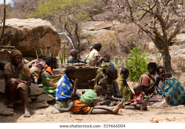 MANGOLA, TANZANIA - AUGUST 14: A hadzabe women with their childrene, only about 1000 people of this tribe are left, they still live in the old way August 14, 2015 in Mangola, Tanzania