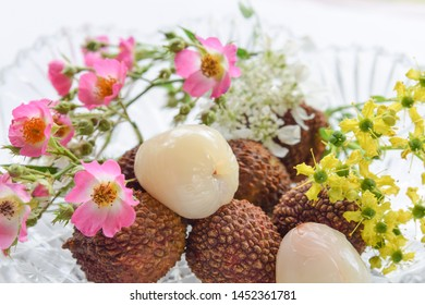 mangosteen fruits with flowers in white background