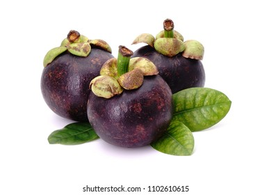 Mangosteen with green leaves, isolated on white background. Mangosteens, the famous delicious fruit from Thailand, In Asia its also known as The Queen of Fruits.