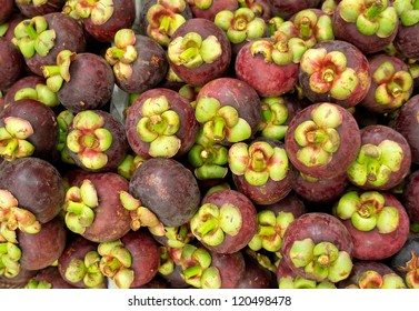 A lot of mangosteens in the market of Thailand