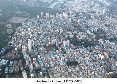 Mangroves, slums and highrises in Mumbai city