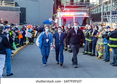 Manhasset, NY - April 7, 2020: Nassau County first responders line up to salute heroes from front lines of COVID-19 pandemic at North Shore University Hospital where medical personnel leaves day shift