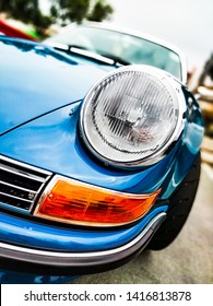 MANHATTAN BEACH, CA - JUNE 1, 2019: Classic Porsche chrome headlight and trim detail close up.