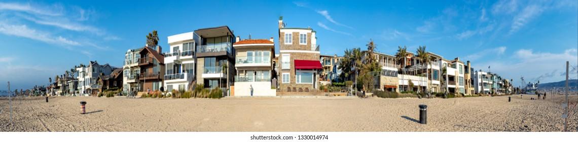 MANHATTAN BEACH, USA - MAR 4, 2019: scenic beach houses at the promenade of Manhattan beach, USA near Los Angeles.