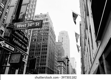 Manhattan beautiful street view with big buildings and flags, New York, USA. Financial district. Business and travel background. Black and white postcard.