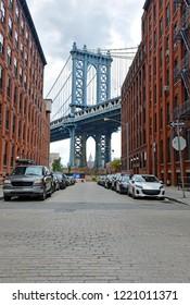Manhattan Bridge and cobblestone street in Brooklyn New York