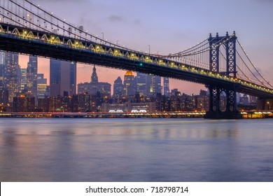 Manhattan Bridge and Downtown Manhattan viewed from Brooklyn Bridge Park during sunset