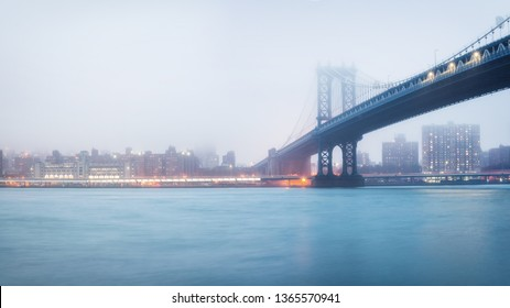 Manhattan bridge and Manhattan at foggy evening, New York City