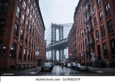 Manhattan bridge New York City. USA. New York in a foggy day.