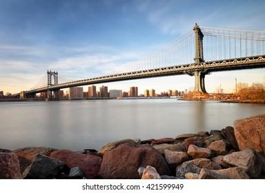 Manhattan Bridge over East River at sunset in New York City Manhattan