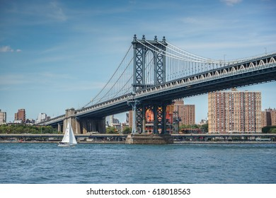 Manhattan Bridge with a sailboat