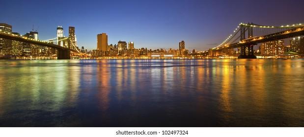 Manhattan Bridge and Manhattan skyline At Night