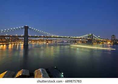 Manhattan Bridge spanning the East River illuminated at night with long exposure