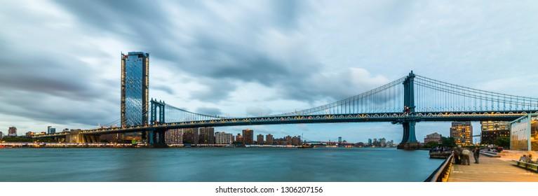 Manhattan Bridge at sunset view. New York City, USA. Manhattan Bridge viewed from Brooklyn Bridge Park.