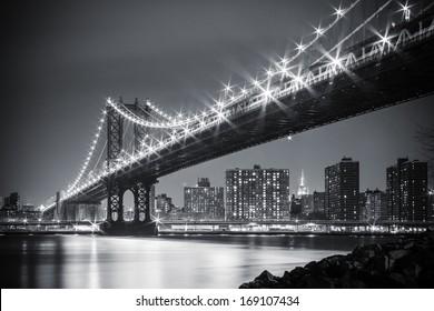 The Manhattan Bridge twinkling on a calm winter's night, as viewed from Brooklyn Bridge Park.