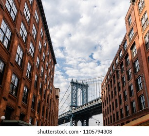 Manhattan bridge view from the narrow street of Brooklyn
