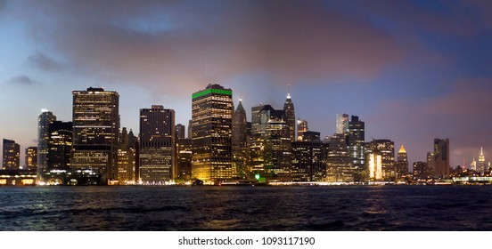 Manhattan buildings viewed from Brooklyn side and East river New York