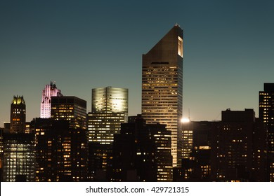 Manhattan cityscape detail with modern skyscrapers and business buildings during twilight in New York City, USA.