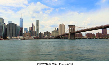 Manhattan financial district with skyscrapers and Brooklyn Bridge. Panoramic view of New York.