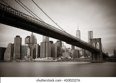 Manhattan financial district with skyscrapers and Brooklyn Bridge black and white.