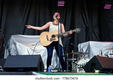 Manhattan, Kansas, USA, 27th June,  2015 Caroline Kole an American Country singer, songwriter, and guitarist pereforms on stage at the annual Kicker Country Stampede music festival in Manhattan Kansas