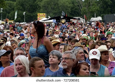 "Manhattan, Kansas, USA, 28th June, 2015 Concert goers at the 20th annual ""Kicker Country Stampede"" in Manhattan,Kansas. Deputy Sheriff patrols the concert"