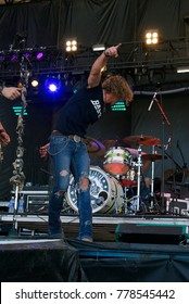 """Manhattan, Kansas, USA, 28th June,  2015 Country music band """"Blackjack Billy"""" performs on stage at the annual Kicker Country Stampede in Manhattan, Kansas."""
