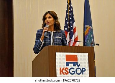 Manhattan Kansas USA, April 24, 2021 South Dakota Governor Kristi Noem addresses the annual Kansas State Republican Convention from the podium in the main ballroom of the Hilton Garden Hotel