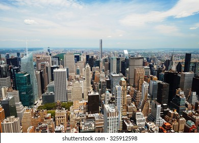 Manhattan midtown panorama view with big skyscrapers, New York City, USA. Manhattan beautiful skyline, NYC panorama. Top of the buildings in financial district. Business background.