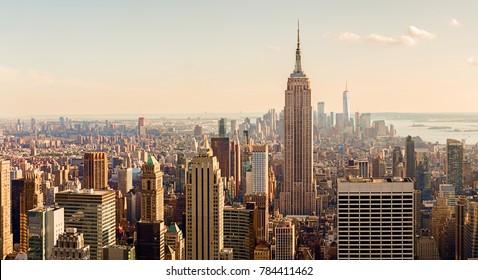 Manhattan Midtown Skyline with illuminated skyscrapers at sunset. NYC, USA