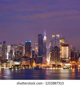 Manhattan midtown skyscrapers and New York City skyline at night