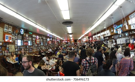 Manhattan, New York - 06.02.2017: the interior of Katz's Deli with a lot of people dining inside.