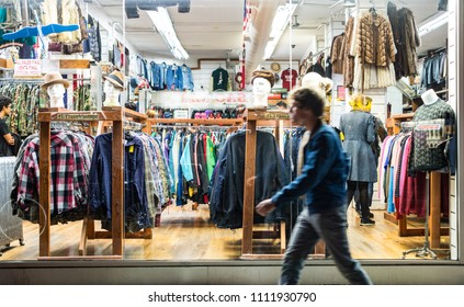 Manhattan , New York - 4th October, 2017: Motion blur of people walking by a vintage style thrift store in the East Village area New York city