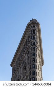 Manhattan, New York / America, USA - april 2019 : Minimal low angle cityscape view over the Flatiron building, and its famous architecture, in with blue sky in background, Midtown Nyc.