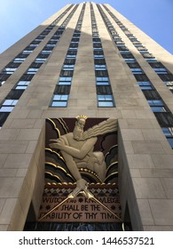 Manhattan, New York / America, USA - april 2019 : Low angle view over the Comcast Building skyscraper and its famous drawing and quote, starting by wisdom and knowledge, Rockefeller Center, Nyc.