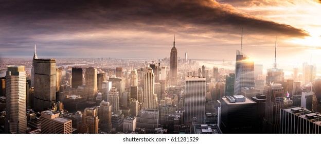 Manhattan, New York in a brilliant sunset with golden light rays piercing through