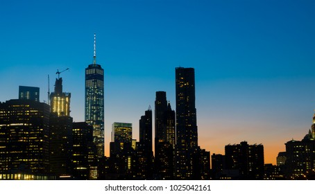 Manhattan New york business center  skyscraper building at sunset viewed from Brooklyn, New york USA