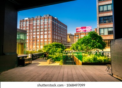Manhattan, New York City - June 14, 2017: The High Line Park in Manhattan New York. The urban park is popular by locals and tourists built on the elevated train tracks above Tenth Ave in New York City