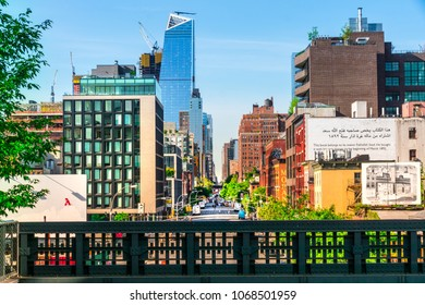 Manhattan, New York City - June 14, 2017: The High Line Park in Manhattan New York. The urban park is popular by locals and tourists built on elevated train tracks. View from 10th ave to Hudson Yards.