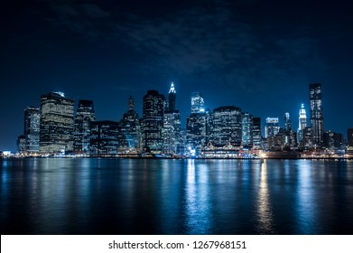 Manhattan, New York city at night view from Brooklyn.