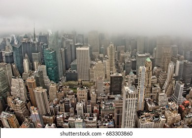 manhattan new york city streets aerial view on foggy day