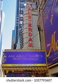 MANHATTAN, NEW YORK CITY/USA - FEBRUARY 21, 2018: The marquee of Disney's Aladdin, A Hit Broadway Musical, which is playing at the New Amsterdam Theatre. Aladdin is directed by Casey Nicholaw.