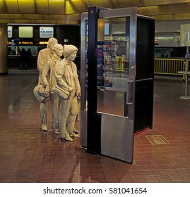 """MANHATTAN, NEW YORK CITY/USA - FEBRUARY 11, 2017: George Segal's """"The Commuters"""" at the Port Authority Bus Terminal."""