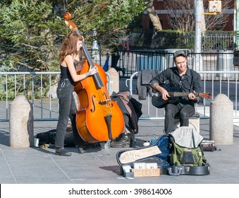 Manhattan, New York - December 06 2015: Street musicians playing during lazy Sunday afternoon in Washington Square Park.
