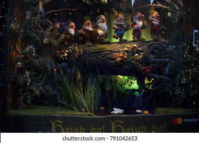 Manhattan, New York, December 20, 2017:  seven dwarves on wood in Saks Fifth Avenue's holiday window display; In celebration of the 80th anniversary of Disney's Snow White and the Seven Dwarfs