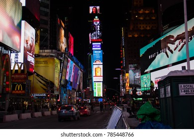 Manhattan: New York, January 1, 2018: road and billboards on buildings at Times Square in nighttime