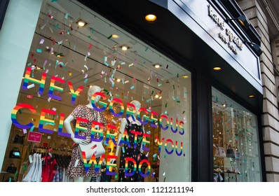 "Manhattan, New York - June 24, 2018: ""Hey gorgeous celebrate you. We do"" at the Kate Spade store window during the 2018 New York City Pride Parade."