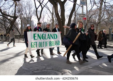 Manhattan, New York March 17, 2017: A part of parade with big sign on st patrick's day and trees at Central Park